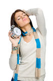 Stretching woman with alarm clock Stock Images