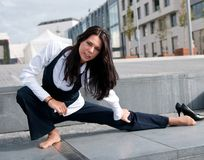 Stretching - woman exercising outside Stock Photos