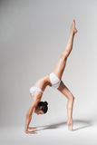 Stretching woman with leg up Royalty Free Stock Photography
