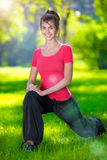 Stretching woman in outdoor sport exercise. Stock Images