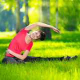 Stretching woman in outdoor sport exercise. Royalty Free Stock Photo