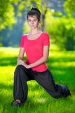 Stretching woman in outdoor sport exercise. Stock Photo
