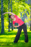 Stretching woman in outdoor sport exercise. Royalty Free Stock Photography