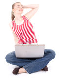 Stretching woman working on laptop Stock Photography