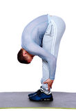 Stretching workout posture by a sports man Royalty Free Stock Photography