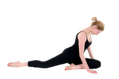 Stretching workout of young female in black Royalty Free Stock Images