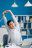 Stretching at workplace Royalty Free Stock Photos