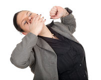 Stretching, yawning overweight, fat businesswoman Stock Photos