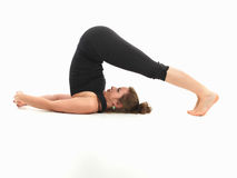 Stretching yoga pose. Young beautiful woman in reversed yoga posture Stock Photography