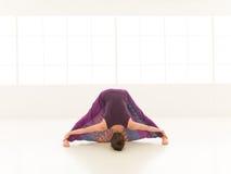 Stretching yoga pose demonstration Stock Image