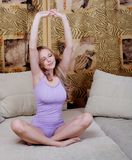 Stretching young woman Royalty Free Stock Image