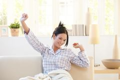 Stretching young woman wearing pyjama Stock Images