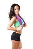 Stretta della donna dell'atleta un tovagliolo dopo un allenamento Fotografie Stock