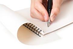 Stretta della mano una penna Fotografia Stock