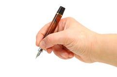 Stretta della mano una penna Immagini Stock