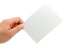 Stretta della mano una scheda di nota Fotografie Stock