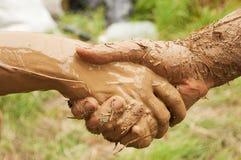 Stretta di mano del fango Fotografia Stock Libera da Diritti