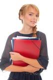 Strette della giovane donna nei documenti delle mani Immagine Stock