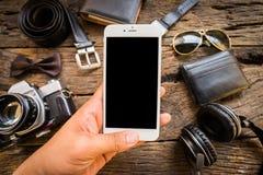 Streven de toevallige Oude camera van mensen, de mobiele telefoon en de levering op bureau na Royalty-vrije Stock Afbeelding
