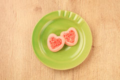 Strew berry heart cookies Royalty Free Stock Image