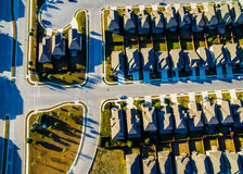 Striaght down Development Modern Homes Vast Texas Hill Country rows of cookie cutter houses. Sunset Birds Eye View Suburban Homes outside Austin , Texas near royalty free stock photos