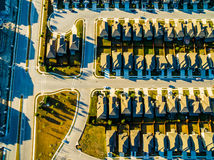 Striaght down Sunset Development Modern Homes Vast Texas Hill Country rows of cookie cutter houses. Sunset Birds Eye View Suburban Homes outside Austin , Texas Royalty Free Stock Photography