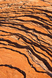 Striated Rock Background. Abstract background of red rock and pebbles pattern Stock Photo