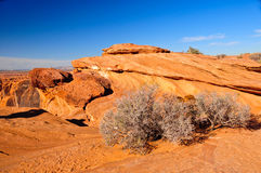 Striated rock strata in the Arizona desert Stock Images