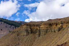 Striations on the cliff side. Royalty Free Stock Photos