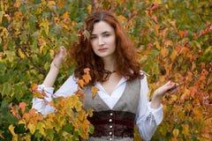 Strict autumn girl. Near birch Stock Photo