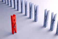 Strict boss!. Red clothespin as a symbol of strict boss royalty free stock images