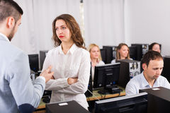 Strict boss and crying clerk Royalty Free Stock Image