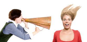 Strict boss shouting at businesswoman through old Stock Image
