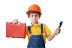 Strict boy in hardhat with tools kit Stock Photos