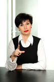 Strict business woman. Portrait of a beautiful strict woman in a costume suit stock photo
