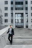 Strict businessman. Side view of a full-length attractive young Royalty Free Stock Photos
