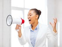 Strict businesswoman shouting in megaphone Royalty Free Stock Photos