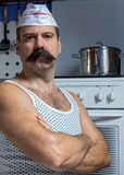 Strict cook in undershirt Royalty Free Stock Images
