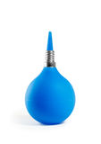 Strict cure. Blue enema with a metallic thread on a white background Royalty Free Stock Photo