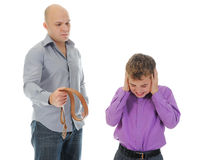 Strict father punishes his son Stock Images