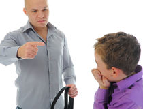 Strict father punishes his son Royalty Free Stock Image