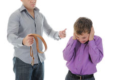 Strict father punishes his son Stock Image