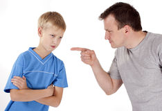 Strict father punishes his son. Strict father punishes, abuses his son. Isolated on white background Royalty Free Stock Photo