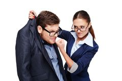 Strict female boss holding afraid businessman by Royalty Free Stock Photos