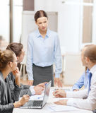 Strict female boss talking to business team Royalty Free Stock Image