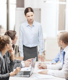 Strict female boss talking to business team Royalty Free Stock Photo