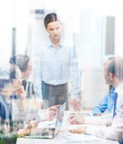 Strict female boss talking to business team Stock Photography