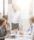 Strict female boss talking to business team Royalty Free Stock Photos