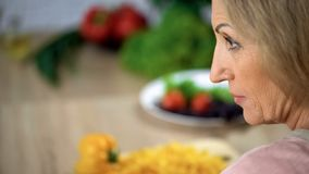 Strict female face, scolding wife home kitchen, annoyed lady closeup, skepticism. Stock photo stock image