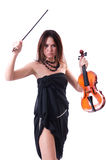 The strict girl. Beautiful brunette girl with violin standing on white background Royalty Free Stock Images